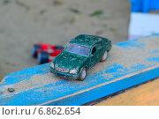 Детские игрушки машинки в песочнице. Стоковое фото, фотограф Илья Пермяков / Фотобанк Лори