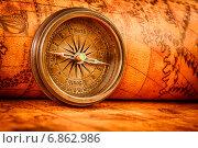 Купить «Vintage compass lies on an ancient world map.», фото № 6862986, снято 23 декабря 2014 г. (c) Андрей Армягов / Фотобанк Лори