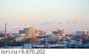 Купить «Городской индустриальный пейзаж в освещении заходящего солнца зимой», эксклюзивное фото № 6870202, снято 6 января 2015 г. (c) Александр Замараев / Фотобанк Лори
