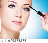 Купить «Woman applying mascara on eyelashes with makeup brush», фото № 6878878, снято 29 мая 2013 г. (c) Валуа Виталий / Фотобанк Лори