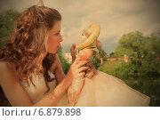 Купить «Девушка играет с куклой на фоне облачного неба», фото № 6879898, снято 3 июля 2008 г. (c) Astroid / Фотобанк Лори
