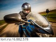 Купить «Biker racing on the road», фото № 6882578, снято 16 мая 2014 г. (c) Андрей Армягов / Фотобанк Лори
