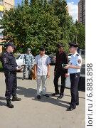 Сотрудники патрульно-постовой службы полиции (2013 год). Редакционное фото, фотограф Free Wind / Фотобанк Лори