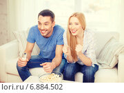 Купить «smiling couple with popcorn cheering sports team», фото № 6884502, снято 9 февраля 2014 г. (c) Syda Productions / Фотобанк Лори