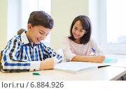 Купить «group of school kids writing test in classroom», фото № 6884926, снято 15 ноября 2014 г. (c) Syda Productions / Фотобанк Лори