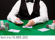 Купить «holdem dealer with playing cards and casino chips», фото № 6885202, снято 16 мая 2014 г. (c) Syda Productions / Фотобанк Лори