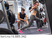 Купить «man and woman with barbell flexing muscles in gym», фото № 6885342, снято 30 ноября 2014 г. (c) Syda Productions / Фотобанк Лори