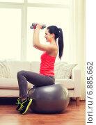 Купить «smiling girl exercising with fitness ball», фото № 6885662, снято 1 апреля 2014 г. (c) Syda Productions / Фотобанк Лори
