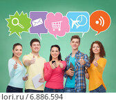 Купить «group of teenagers with smartphones and tablet pc», фото № 6886594, снято 22 июня 2014 г. (c) Syda Productions / Фотобанк Лори