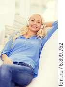 Купить «smiling young girl in headphones at home», фото № 6899762, снято 6 февраля 2014 г. (c) Syda Productions / Фотобанк Лори