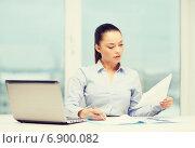 Купить «businesswoman with laptop and charts in office», фото № 6900082, снято 8 декабря 2013 г. (c) Syda Productions / Фотобанк Лори