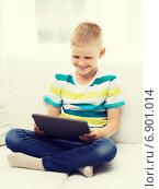 Купить «smiling boy with tablet computer at home», фото № 6901014, снято 3 июня 2014 г. (c) Syda Productions / Фотобанк Лори