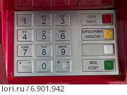 Купить «Металлическая клавиатура банкомата крупным планом на красном фоне», фото № 6901942, снято 10 января 2015 г. (c) Александр Степанов / Фотобанк Лори