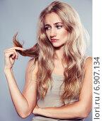 Young woman looking at split ends. Стоковое фото, фотограф Гладских Татьяна / Фотобанк Лори