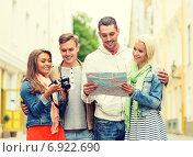 Купить «group of smiling friends with map and photocamera», фото № 6922690, снято 14 июня 2014 г. (c) Syda Productions / Фотобанк Лори