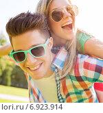 Купить «smiling couple having fun in park», фото № 6923914, снято 7 июля 2014 г. (c) Syda Productions / Фотобанк Лори