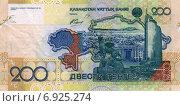 Купить «Купюра 200 тенге 2006 года выпуска (обратная сторона)», фото № 6925274, снято 1 января 2015 г. (c) Александр Тараканов / Фотобанк Лори