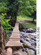 Купить «Подвесной деревянный мостик над горной рекой», фото № 6936846, снято 6 июля 2013 г. (c) Евгений Ткачёв / Фотобанк Лори