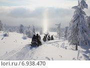 Купить «Поездка на снегоходах по зимнему лесу», фото № 6938470, снято 7 января 2013 г. (c) Ирина Толокновская / Фотобанк Лори
