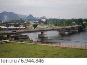 Купить «Вид на реку Квай и Канчанабури, Таиланд», фото № 6944846, снято 11 января 2015 г. (c) Natalya Sidorova / Фотобанк Лори