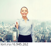 Купить «businesswoman with opened hand ready for handshake», фото № 6945262, снято 8 декабря 2013 г. (c) Syda Productions / Фотобанк Лори