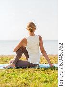 Купить «woman making yoga exercises outdoors», фото № 6945762, снято 6 августа 2014 г. (c) Syda Productions / Фотобанк Лори