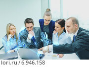business team with laptop having discussion. Стоковое фото, фотограф Syda Productions / Фотобанк Лори