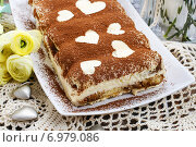 Купить «Tiramisu cake decorated with hearts. Party dessert», фото № 6979086, снято 11 июля 2020 г. (c) BE&W Photo / Фотобанк Лори