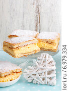 Купить «A Polish cream pie made of two layers of puff pastry, filled with whipped cream. Party dessert», фото № 6979334, снято 23 октября 2018 г. (c) BE&W Photo / Фотобанк Лори