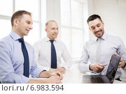 Купить «smiling businessmen having discussion in office», фото № 6983594, снято 10 мая 2014 г. (c) Syda Productions / Фотобанк Лори