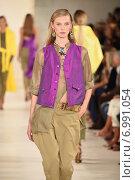 Купить «NEW YORK, NY - SEPTEMBER 11: A model walks the runway at Ralph Lauren fashion show during Mercedes-Benz Fashion Week Spring 2015 on September 11, 2014 in New York City.», фото № 6991054, снято 11 сентября 2014 г. (c) Anton Oparin / Фотобанк Лори