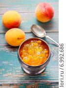 Купить «Vintage silver goblet of peach jam standing on a rustic wooden table», фото № 6992686, снято 20 ноября 2018 г. (c) BE&W Photo / Фотобанк Лори