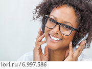 Купить «African American Girl Listening to MP3 Player Headphones», фото № 6997586, снято 29 ноября 2013 г. (c) Ingram Publishing / Фотобанк Лори
