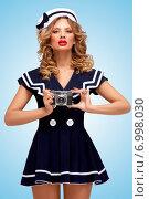 Купить «Sailor girl with camera.», фото № 6998030, снято 27 апреля 2014 г. (c) Ingram Publishing / Фотобанк Лори