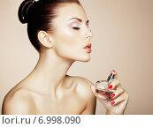Купить «Young beautiful woman with bottle of perfume. Perfect Makeup», фото № 6998090, снято 1 сентября 2013 г. (c) Ingram Publishing / Фотобанк Лори
