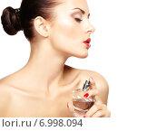 Купить «Young woman applying perfume on herself isolated on white background», фото № 6998094, снято 1 сентября 2013 г. (c) Ingram Publishing / Фотобанк Лори
