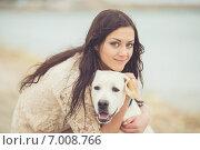 Купить «The young woman on an autumn beach with a dog.», фото № 7008766, снято 12 декабря 2017 г. (c) Александр Савченко / Фотобанк Лори