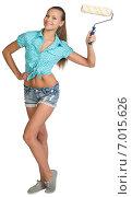 Купить «Красивая девушка в шортах и рубашке с малярным валиком», фото № 7015626, снято 8 декабря 2014 г. (c) Кирилл Черезов / Фотобанк Лори