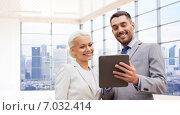 Купить «smiling businessmen with tablet pc outdoors», фото № 7032414, снято 19 августа 2014 г. (c) Syda Productions / Фотобанк Лори