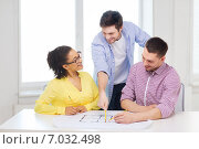 Купить «three smiling architects working in office», фото № 7032498, снято 17 мая 2014 г. (c) Syda Productions / Фотобанк Лори