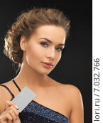 Купить «woman in evening dress with plastic card», фото № 7032766, снято 17 марта 2013 г. (c) Syda Productions / Фотобанк Лори