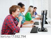 Купить «student with computer studying at school», фото № 7032794, снято 16 июня 2013 г. (c) Syda Productions / Фотобанк Лори