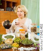 Купить «mature woman with herbal tea», фото № 7042402, снято 20 мая 2014 г. (c) Яков Филимонов / Фотобанк Лори