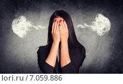 Купить «У деловой женщины, закрывшей лицо руками, идет дым из ушей», фото № 7059886, снято 19 октября 2018 г. (c) Кирилл Черезов / Фотобанк Лори