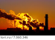 Купить «Промышленный пейзаж с трубами и дымом на фоне заката», фото № 7060346, снято 11 октября 2007 г. (c) Vasily Smirnov / Фотобанк Лори
