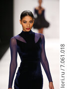 Купить «NEW YORK, NY - FEBRUARY 19: A model walks the runway in a Walter Mendez design at the Art Hearts Fashion show during MBFW Fall 2015 at Lincoln Center on February 19, 2015 in NYC.», фото № 7061018, снято 19 февраля 2015 г. (c) Anton Oparin / Фотобанк Лори
