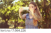 Купить «In high quality 4k format pretty blonde taking a selfie », видеоролик № 7064226, снято 19 марта 2019 г. (c) Wavebreak Media / Фотобанк Лори
