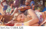 Купить «In high quality format pretty hipster relaxing on campsite », видеоролик № 7064326, снято 19 марта 2019 г. (c) Wavebreak Media / Фотобанк Лори