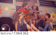 Купить «In high quality format hipster friends sitting by their camper van », видеоролик № 7064362, снято 24 января 2019 г. (c) Wavebreak Media / Фотобанк Лори