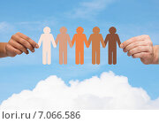 hands holding paper chain multiracial people. Стоковое фото, фотограф Syda Productions / Фотобанк Лори